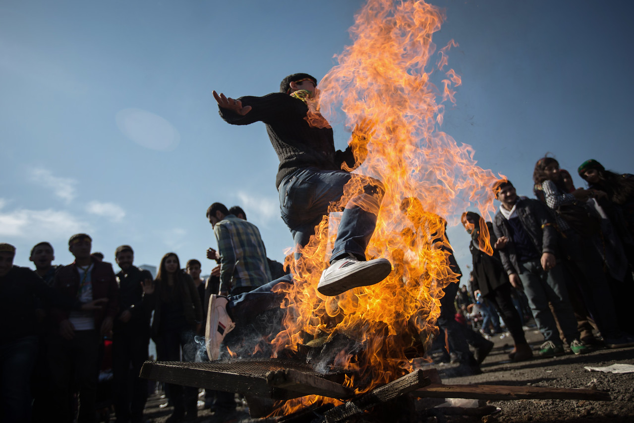 A Kurdish boy jumps over the fire during the Newroz festival which mark the first day of spring in Zeytinburnu, Istanbul, Turkey, Sunday 22 March, 2015 During Newroz people display red, green and yellow flags of the Kurdish rebel group PKK. The Kurds use the Newroz festival to promote the Kurdish culture. (Andrés Gutiérrez/TheStand)