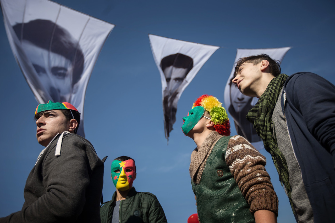 A group of Kurdish boys wearing masks with the colors of the PKK during the Newroz festival which mark the first day of spring in Zeytinburnu, Istanbul, Turkey, Sunday 22 March, 2015 During Newroz people display red, green and yellow flags of the Kurdish rebel group PKK. The Kurds use the Newroz festival to promote the Kurdish culture. (Andrés Gutiérrez/TheStand)