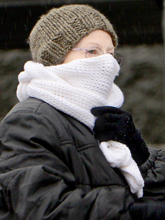 Kevin Harvison | Staff photo<br /> An unidentified woman keeps warm while outside in McAlester.