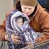 Kevin Harvison | Staff photo<br /> Bundled up baby Blyth Brooks gets snuggled for warmth from Grandma April Edwards as the two head to their vehicle from Wal-mart.