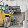 Kevin Harvison | Staff photo<br /> McAlester City Employee Robert Young uses a frontend loader on the city supply of salt in preparation for any icy roads.