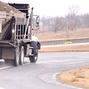 Kevin Harvison | Staff photo<br /> State vehicle heads north on U.S. Highway 69 off of Carl Albert Parkway preparing to treat the roadways.