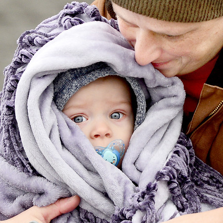 Kevin Harvison | Staff photo<br /> Bundled up baby Blyth Brooks gets snuggled for warmth from Grandma April Edwards as the two head to their vehicle Wednesday morning.
