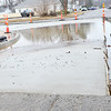 Kevin Harvison | Staff photo<br /> Slope of new road work at the corner of Comanche Avenue and Third Street has water standing.