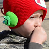 Kevin Harvison | Staff photo<br /> Kooper Warner makes sure to keep the wind at check whie wearing a stocking hat and ear muff combo.