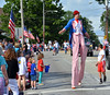 Entertainer, John Hadfields was a man on stilts as he paraded down Easton Rd. Photo by Debby High