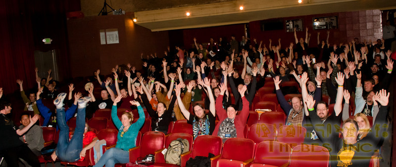 The audience cheers in the Hollywood Theater's main theater.