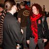 Laurel Dodge converses with a ponytailed participant