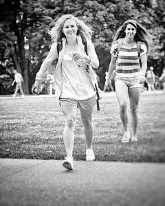Haili and Nicole on CMU campus near picnic tables.