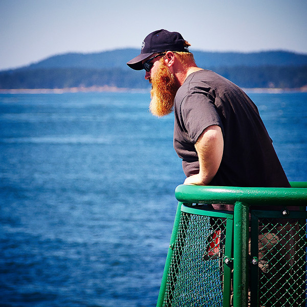 I really liked the orange/red of this man's beard against the blue water. It paired nicely with the green railing, too.