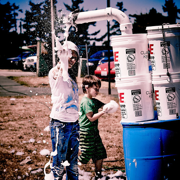 Kids having a good time playing with a super-duper suds maker at the art festival in Friday Harbor, WA.