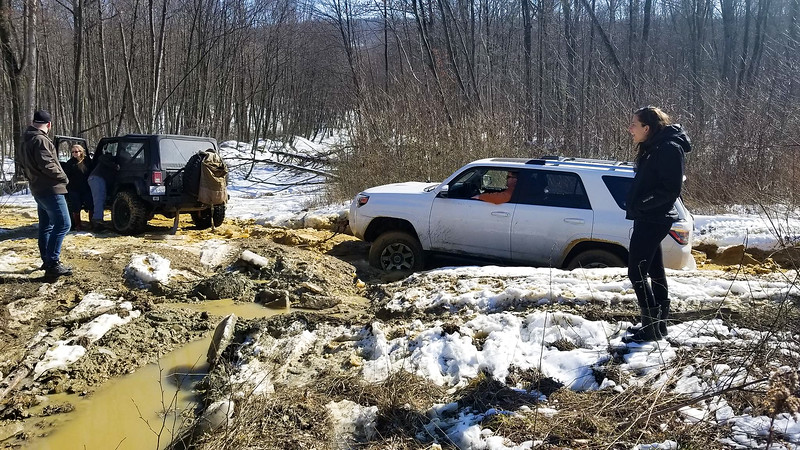Stuck in a mud pit, high centered on a large chunk of ice.