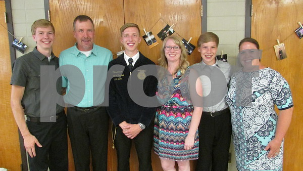 Sycamore High School agriculture education teacher Kara Poynter (far right) joins the Clausen family for a photo during Saturday's open house to recognize Chase Clausen (third from left) as the new Illinois Association FFA treasurer.