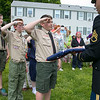 The Fitchburg Housing Authority held a ceremony for the 75th Anniversary of the Battle of D-Day June 6th, 1944  at the Green Acres Normandy Road rebuilt flag pole. The American Flag will now be flying for the first time in 25 years. Handing over the flag to U.S. Army Staff Sgt. Benjamin Lim during the ceremony is Fitchburg Scout from Troop 41 Patrick McWalter, 13. He then saluted with fellow scouts Zack Plant, 12, and Avonlea Radue, 10. SENTINEL & ENTERPRISE/JOHN LOVE