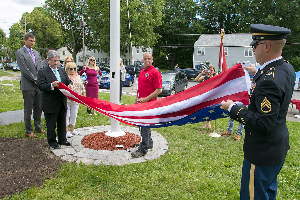 . The Fitchburg Housing Authority held a ceremony for the 75th Anniversary of the Battle of D-Day June 6th, 1944  at the Green Acres Normandy Road rebuilt flag pole. The American Flag will now be flying for the first time in 25 years. Fitchburg Mayor Stephen DiNatale and U.S. Army Staff Sgt. Benjamin Lim unfold the flag so it could be raised again. SENTINEL & ENTERPRISE/JOHN LOVE