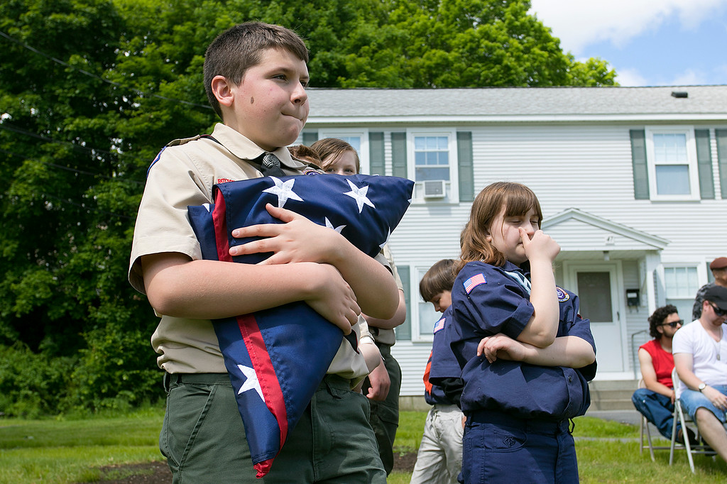 . The Fitchburg Housing Authority held a ceremony for the 75th Anniversary of the Battle of D-Day June 6th, 1944  at the Green Acres Normandy Road rebuilt flag pole. The American Flag will now be flying for the first time in 25 years. Holding the flag during the ceremony is Fitchburg Scout from Troop 41 Patrick McWalter, 13. SENTINEL & ENTERPRISE/JOHN LOVE