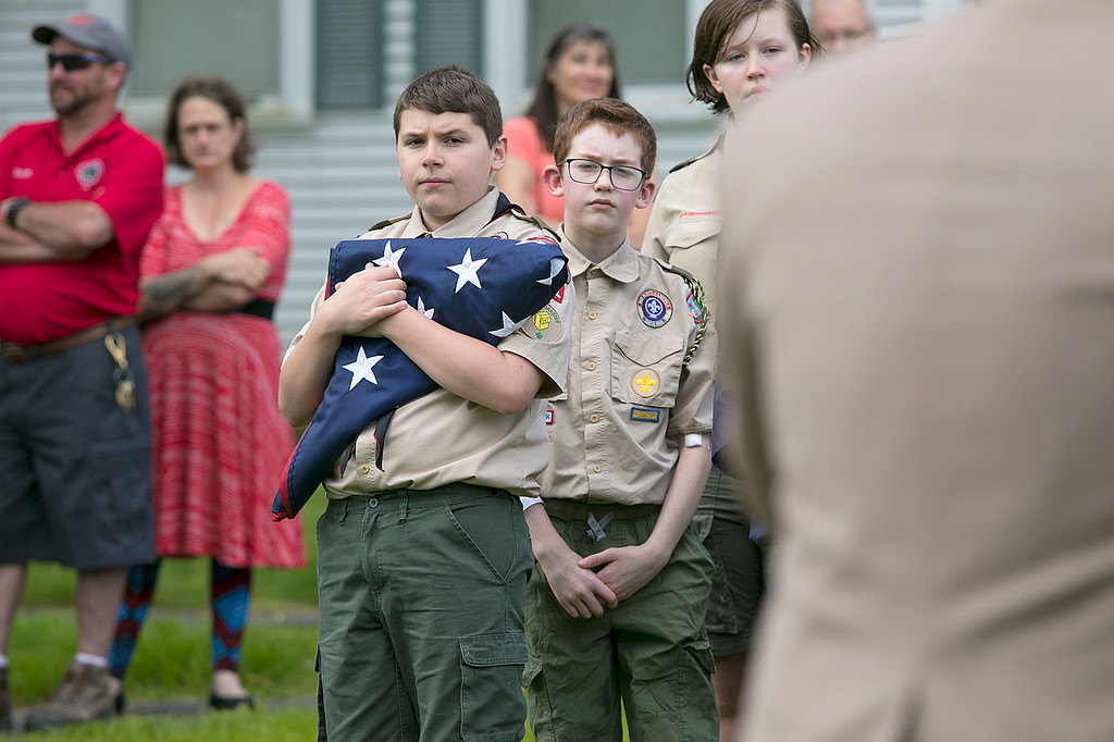 . The Fitchburg Housing Authority held a ceremony for the 75th Anniversary of the Battle of D-Day June 6th, 1944  at the Green Acres Normandy Road rebuilt flag pole. The American Flag will now be flying for the first time in 25 years. Holding the American flag during the ceremony is Patrick McWalter, 13, with Fitchburg Scout Troop 41. SENTINEL & ENTERPRISE/JOHN LOVE