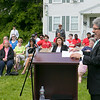 The Fitchburg Housing Authority held a ceremony for the 75th Anniversary of the Battle of D-Day June 6th, 1944  at the Green Acres Normandy Road rebuilt flag pole. The American Flag will now be flying for the first time in 25 years. Addressing the crowd at the ceremony is Fitchburg Mayor Stephen DiNatale. SENTINEL & ENTERPRISE/JOHN LOVE