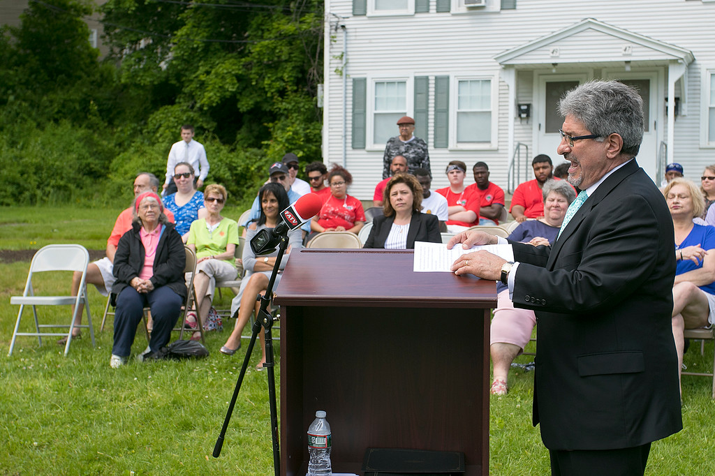 . The Fitchburg Housing Authority held a ceremony for the 75th Anniversary of the Battle of D-Day June 6th, 1944  at the Green Acres Normandy Road rebuilt flag pole. The American Flag will now be flying for the first time in 25 years. Addressing the crowd at the ceremony is Fitchburg Mayor Stephen DiNatale. SENTINEL & ENTERPRISE/JOHN LOVE