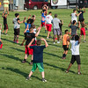 Kids at the Friday NIght Football Clinic at NIkitas Field start out with some calisthenics. Fitchburg High varsity football coaches and players hosted the free clinic for kids in grades K-12 on Friday, July 21, 2017. SENTINEL&ENTERPRISE/ Jim Marabello