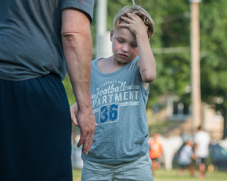 A young attendee listens as he gets instruction on lineman drills at the Fitchburg Free Friday Night Football Clinic at Nikitas Field.  SENTINEL&ENTERPRISE/ Jim Marabello
