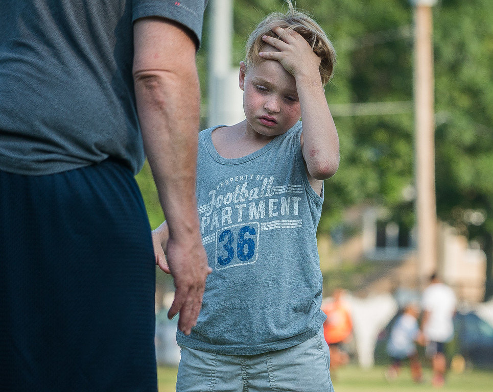 . A young attendee listens as he gets instruction on lineman drills at the Fitchburg Free Friday Night Football Clinic at Nikitas Field.  SENTINEL&ENTERPRISE/ Jim Marabello