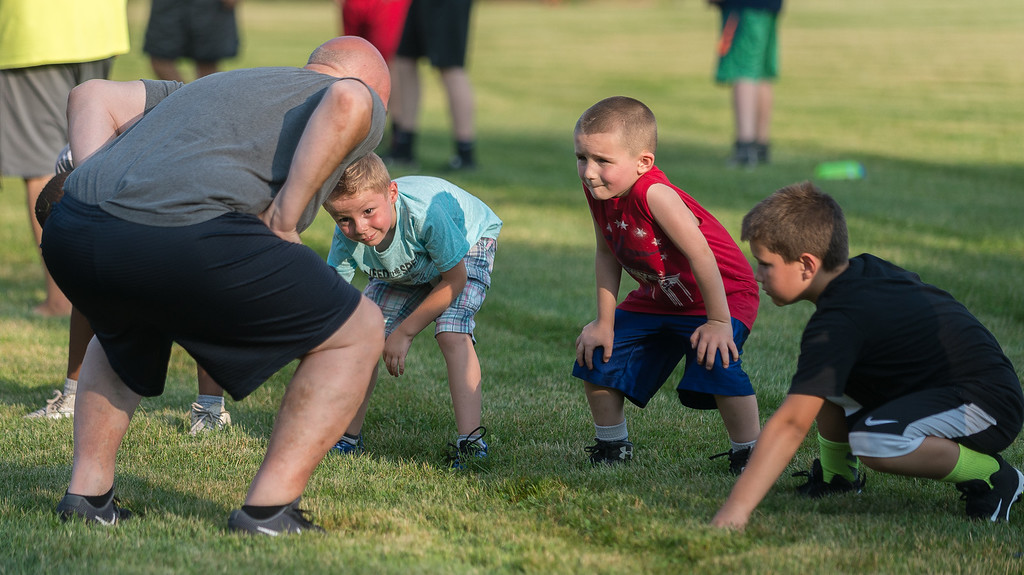. Coach Jamie Arciprete instructs students at the Fitchburg Free Friday NIght Football Clinic held at NIkitas Field. SENTINEL&ENTERPRISE/ Jim Marabello