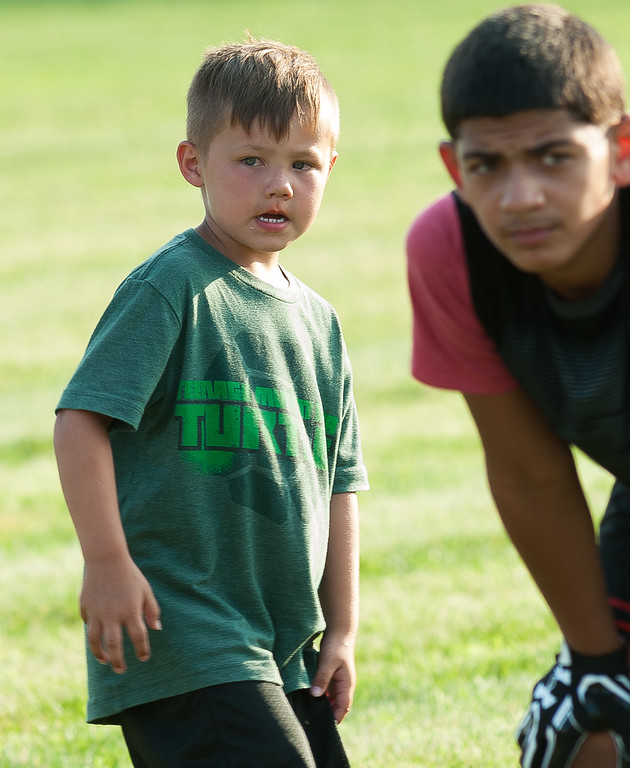 . A young attendee gets his game face on at the Fitchburg Free Friday NIght Football Clinic at Nikitas Field.  SENTINEL&ENTERPRISE/ Jim Marabello