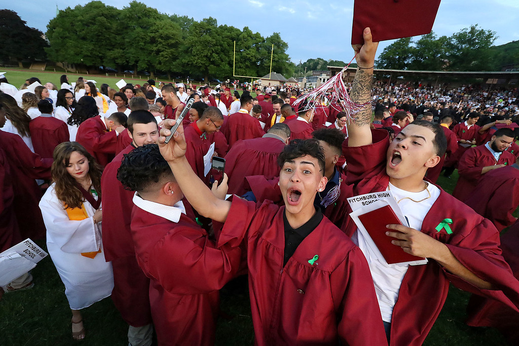 . Fitchburg High School held its 152 commencement exercises on June 1, 2018 at Crocker Field in Fitchburg. Graduates cheer after throwing their caps into the air to end the ceremony. SENTINEL & ENTERPRISE/JOHN LOVE