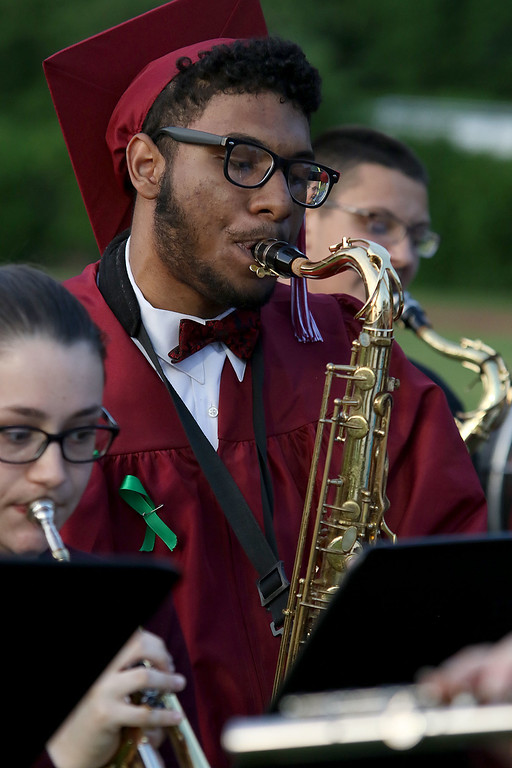 . Fitchburg High School held its 152 commencement exercises on June 1, 2018 at Crocker Field in Fitchburg. Graduate Giovanni Soto plays the saxophone with the school band during the ceremony. SENTINEL & ENTERPRISE/JOHN LOVE