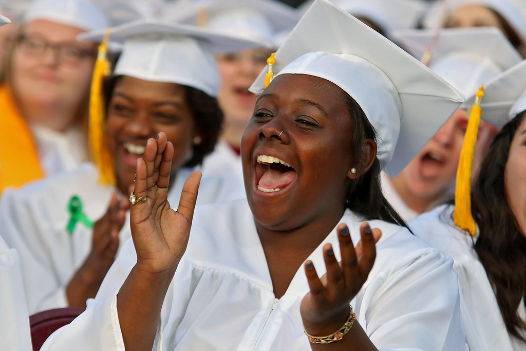 . Fitchburg High School held its 152 commencement exercises on June 1, 2018 at Crocker Field in Fitchburg.Graduate Nyejah Johnson cheers on her fellow classmates as they get their diplomas. SENTINEL & ENTERPRISE/JOHN LOVE
