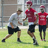 Coach Dan Walker directs Fitchburg High School football players as they run drills during the first official day of practice on Friday morning. SENTINEL & ENTERPRISE / Ashley Green