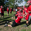 Fitchburg High School football players run drills during the first official day of practice on Friday morning. SENTINEL & ENTERPRISE / Ashley Green
