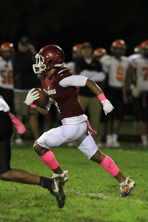 . Fitchburg High School football played Marlborough High School on Friday night, October 5, 2018. FHS\'s Devin DeLeon takes off for a great run after a catch in the first half. SENTINEL & ENTERPRISE/JOHN LOVE