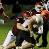 Fitchburg High School football played Marlborough High School on Friday night, October 5, 2018. FHS's Rocco Arciprete takes down MHS's Lou Vigeant during action in the game. SENTINEL & ENTERPRISE/JOHN LOVE