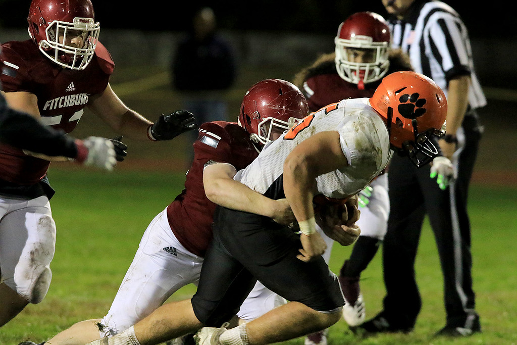 . Fitchburg High School football played Marlborough High School on Friday night, October 5, 2018. FHS\'s Rocco Arciprete takes down MHS\'s Lou Vigeant during action in the game. SENTINEL & ENTERPRISE/JOHN LOVE