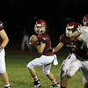 Fitchburg High School football played Marlborough High School on Friday night, October 5, 2018. FHS's Quarterback Andrew Brooks looks for a receiver to pass to during action in the game. SENTINEL & ENTERPRISE/JOHN LOVE