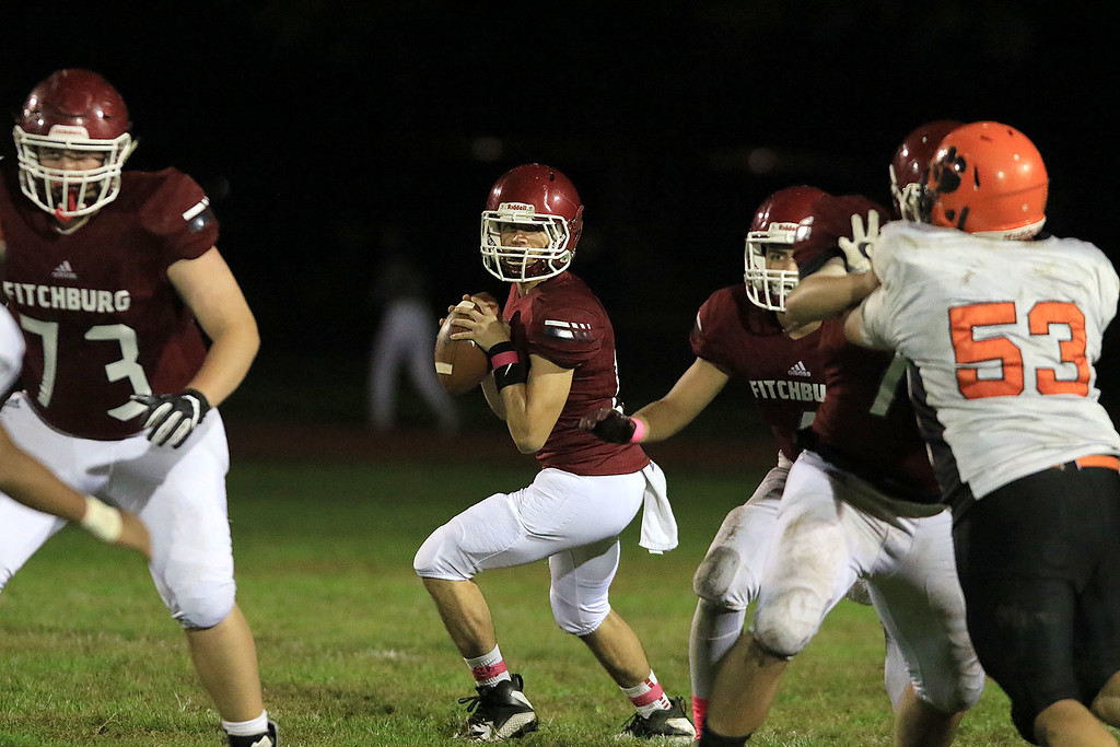 . Fitchburg High School football played Marlborough High School on Friday night, October 5, 2018. FHS\'s Quarterback Andrew Brooks looks for a receiver to pass to during action in the game. SENTINEL & ENTERPRISE/JOHN LOVE