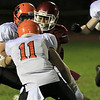 Fitchburg High School football played Marlborough High School on Friday night, October 5, 2018. FHS's Ozzy Guy tries to split two defenders during action in the game. SENTINEL & ENTERPRISE/JOHN LOVE