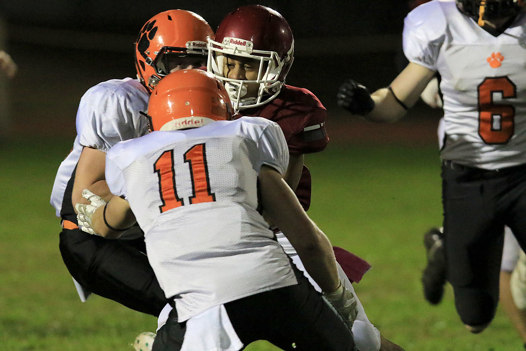 . Fitchburg High School football played Marlborough High School on Friday night, October 5, 2018. FHS\'s Ozzy Guy tries to split two defenders during action in the game. SENTINEL & ENTERPRISE/JOHN LOVE