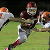 Fitchburg High School football played Marlborough High School on Friday night, October 5, 2018. FHS's Anthony Oquendo tries to get by MHS's Justin Bates (11) during action in the game. SENTINEL & ENTERPRISE/JOHN LOVE