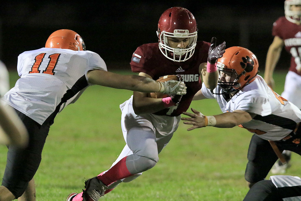 . Fitchburg High School football played Marlborough High School on Friday night, October 5, 2018. FHS\'s Anthony Oquendo tries to get by MHS\'s Justin Bates (11) during action in the game. SENTINEL & ENTERPRISE/JOHN LOVE