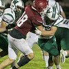 Fitchburg High School played Wachusett Regional High School football on Friday night at Crocker Field in Fitchburg. FHS's Giovanni Marrone hits WRHS's Angelo Smith. SENTINEL & ENTERPRISE/JOHN LOVE