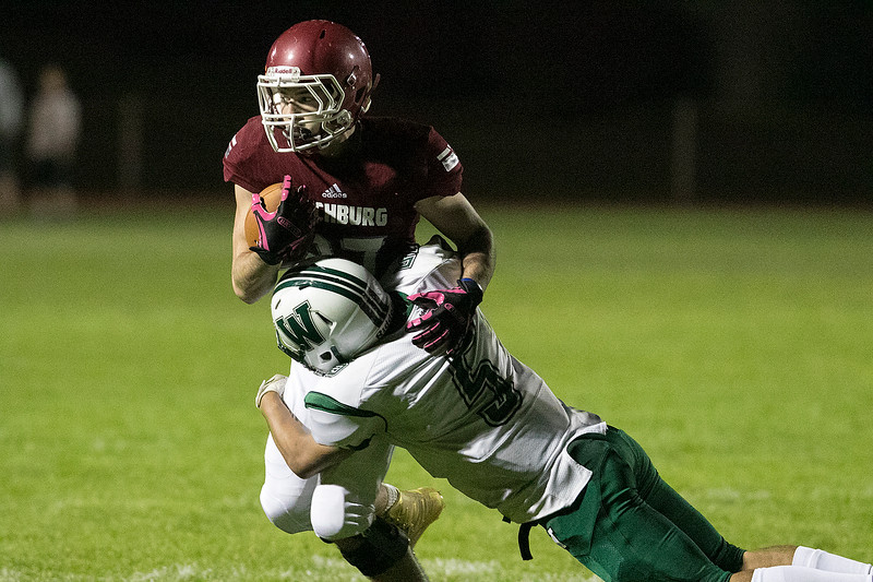 Fitchburg High School played Wachusett Regional High School football on Friday night at Crocker Field in Fitchburg. FHS's Duncan Poitras and WRHS's Caleb Marrero. SENTINEL & ENTERPRISE/JOHN LOVE