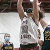The Fitchburg High School girls basketball team played Quabbin Regional on Monday night. FHS's #10 Ilka Negron goes up for a rebound during action in the game. SENTINEL & ENTERPRISE/JOHN LOVE