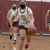 The Fitchburg High School girls basketball team played Quabbin Regional on Monday night. FHS's #11 Alyvia Smith has a break away during action in the game. SENTINEL & ENTERPRISE/JOHN LOVE