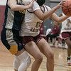 The Fitchburg High School girls basketball team played Quabbin Regional on Monday night. FHS's #11 Alyvia Smith is covered by QRHS's Rose Olivia during action in the game. SENTINEL & ENTERPRISE/JOHN LOVE
