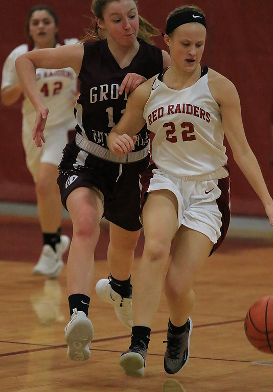 . Groton Dunstable Regional High School girls basketball made it\'s way to Fitchburg to play Fitchburg High School on Friday night, January 18, 2019. GDRHS\'s Emily Smith rush in to stop FHS\'s Emma Auger as she takes the ball up court. SENTINEL & ENTERPRISE/JOHN LOVE