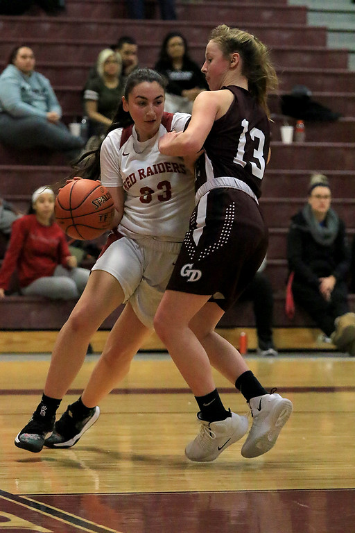 . Groton Dunstable Regional High School girls basketball made it\'s way to Fitchburg to play Fitchburg High School on Friday night, January 18, 2019. FHS\'s Mia Cavins tries to take the ball down the baseline by GDRHS\'s Emily Smith. SENTINEL & ENTERPRISE/JOHN LOVE