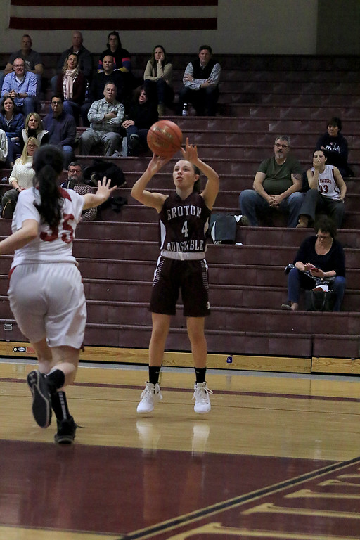 . Groton Dunstable Regional High School girls basketball made it\'s way to Fitchburg to play Fitchburg High School on Friday night, January 18, 2019. GDRHS\'s Caroline Straw takes a shot form the out side. Rushing in to try and block the shot is FHS\'s Siena Armano. SENTINEL & ENTERPRISE/JOHN LOVE